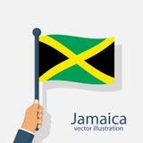 Drapeau de la Jamaïque tenant l'homme disponible Image libre de droits