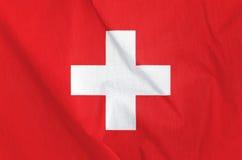 Drapeau de tissu de la Suisse Photos stock