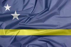 Drapeau de tissu du Curaçao Pli de fond de drapeau du Curaçao photographie stock libre de droits