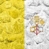 Drapeau de Ville du Vatican sur un mur en pierre illustration stock