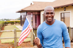 Drapeau des Etats-Unis de jeune homme Images libres de droits