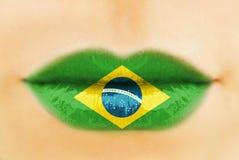 Drapeau du Brésil sur des lèvres Photographie stock