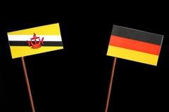 Drapeau du Brunei avec le drapeau allemand d'isolement sur le noir photographie stock libre de droits