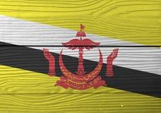 Drapeau du Brunei Darussalam sur le fond en bois de mur Texture grunge de drapeau du Brunei images stock