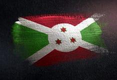 Drapeau du Burundi fait de peinture métallique de brosse sur le mur foncé grunge illustration stock