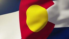 Drapeau du Colorado ondulant dans le vent Le soleil de bouclage illustration de vecteur