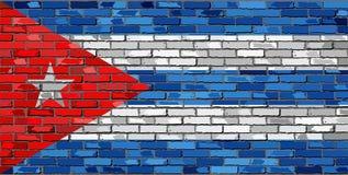 Drapeau du Cuba sur un mur de briques illustration libre de droits