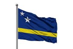 Drapeau du Curaçao ondulant dans le vent, fond blanc d'isolement photographie stock libre de droits