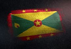 Drapeau du Grenada fait de peinture métallique de brosse sur le mur foncé grunge photos stock