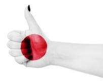 Drapeau du Japon en main Image libre de droits