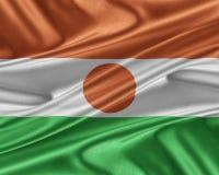 Drapeau du Niger avec une texture en soie brillante Photo stock