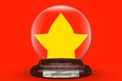 Drapeau du Vietnam sur le globe de neige photographie stock