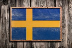Drapeau en bois de la Suède Photographie stock