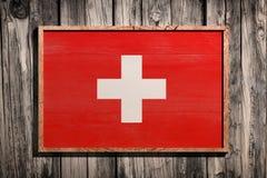 Drapeau en bois de la Suisse Photographie stock