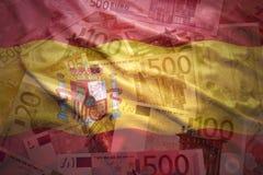 Drapeau espagnol de ondulation coloré sur un euro fond Photographie stock