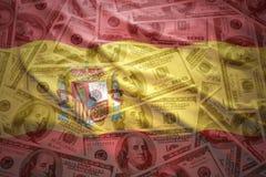 Drapeau espagnol de ondulation coloré sur un fond d'argent du dollar Photos libres de droits