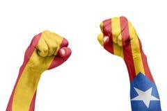 Drapeau espagnol et catalan peint dans la main avec un poing Refere Photographie stock