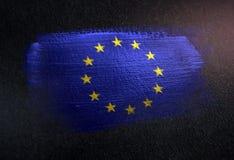Drapeau européen fait de peinture métallique de brosse sur le mur foncé grunge illustration stock
