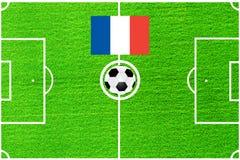 Drapeau français sur le fond d'un terrain de football illustration libre de droits
