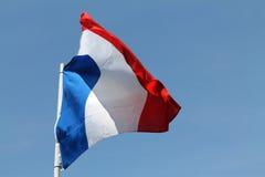 Drapeau français volant haut Photographie stock