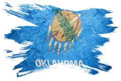 Drapeau grunge d'état de l'Oklahoma Course de brosse de drapeau de l'Oklahoma Photos stock