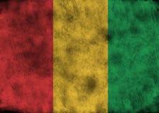 Drapeau grunge de la Guinée Photos libres de droits