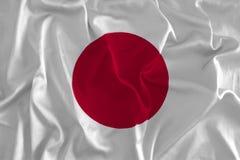 Drapeau japonais sur le fond en soie illustration de vecteur