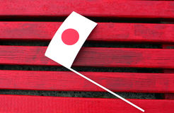 Drapeau japonais sur le fond rouge Photo libre de droits