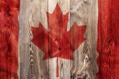 Drapeau national de Canada, fond en bois Photographie stock
