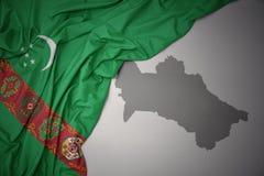 Drapeau national et carte colorés de ondulation du Turkménistan image libre de droits