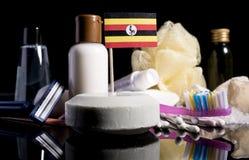 Drapeau ougandais dans le savon avec tous les produits pour les personnes hy Photo libre de droits