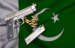 Drapeau pakistanais de lois d'arme à feu avec l'arme à feu et la balle de pistolet image stock