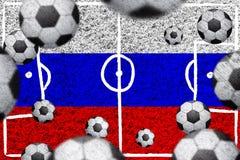 Drapeau russe avec des ballons de football Image stock