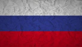 Drapeau russe avec l'effet du papier et du grunge chiffonnés Images stock