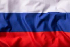 Drapeau russe ondulant dans le vent Photo stock