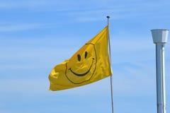 Drapeau souriant de visage Images libres de droits