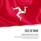 Drapeau soyeux d'île de Man ondulant sur un fond blanc d'isolement avec le secteur blanc des textes pour votre message d'annonce Photographie stock