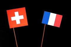 Drapeau suisse avec le drapeau français sur le noir Photos libres de droits