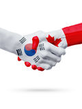 Drapeaux Corée du Sud, pays de Canada, concept de poignée de main d'amitié d'association Photographie stock libre de droits