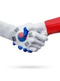 Drapeaux Corée du Sud, pays de Frances, concept de poignée de main d'amitié d'association Image libre de droits