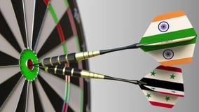 Drapeaux d'Inde et de la Syrie sur des dards frappant la boudine de la cible Coopération internationale ou concurrence 3D concept Images stock