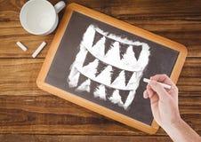 Drapeaux de dessin de main sur le tableau noir avec du café Image stock
