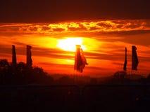Drapeaux de festival au coucher du soleil Image stock