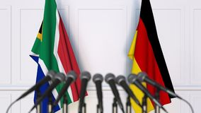 Drapeaux de l'Afrique du Sud et de l'Allemagne à la réunion ou à la conférence internationale rendu 3d Image libre de droits