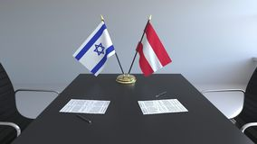 Drapeaux de l'Israël et de l'Autriche et papiers sur la table Négociations et signature d'un accord international 3D conceptuel illustration stock
