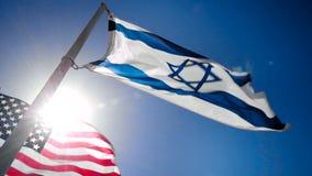 Drapeaux de l'Israël et des Etats-Unis banque de vidéos