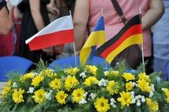 Drapeaux de l'Ukraine, de l'Allemagne et de la Pologne Photos libres de droits