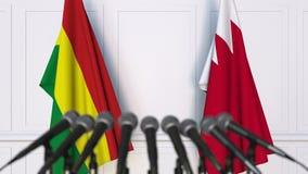 Drapeaux de la Bolivie et du Bahrain ? la conf?rence de presse internationale de r?union ou de n?gociations animation 3D banque de vidéos