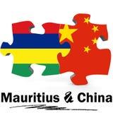 Drapeaux de la Chine et des Îles Maurice dans le puzzle Images stock