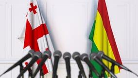 Drapeaux de la Géorgie et de la Bolivie à la conférence de presse internationale de réunion ou de négociations animation 3D banque de vidéos